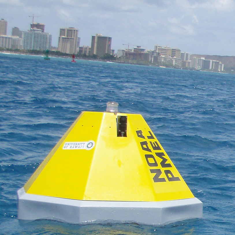 Thumbnail image of yellow buoy floating in blue Hawaiian waters