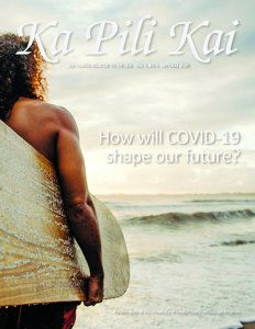 Cover of Ka Pili Kai, Dr. Kapono stands facing the surf, surfboard under his arm.