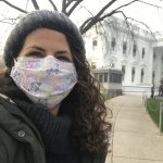 Beth Lenz (masked) poses for a selfie on a path to the White House